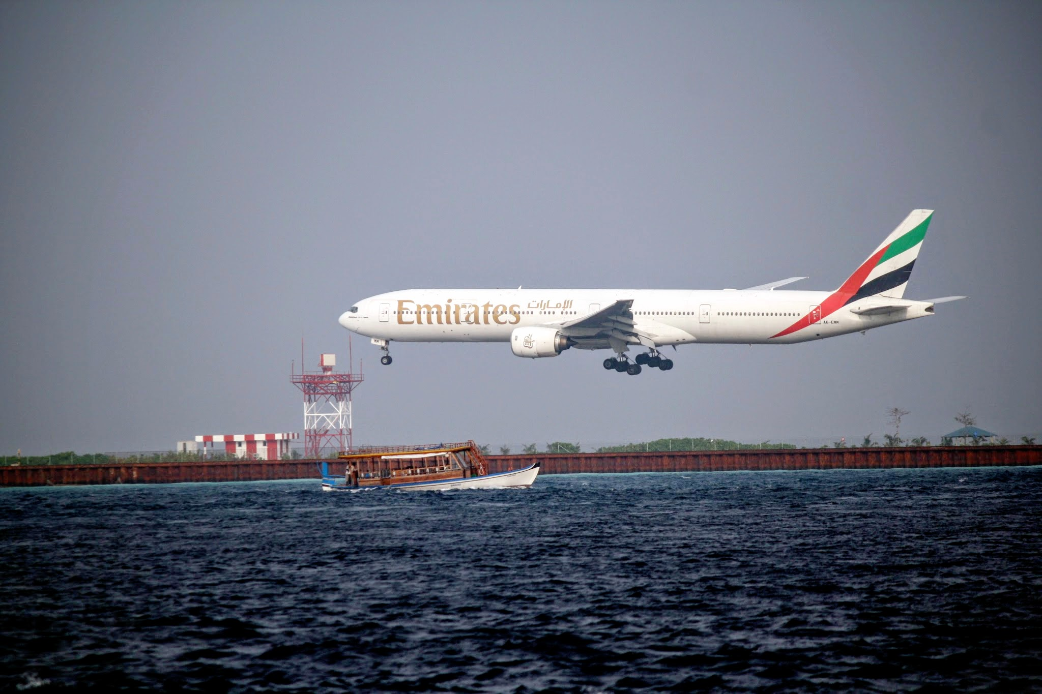 Emirates flight landing at Ibrahim Nasir International Airport