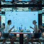 anantara kihavah maldives villas couple dining underwater