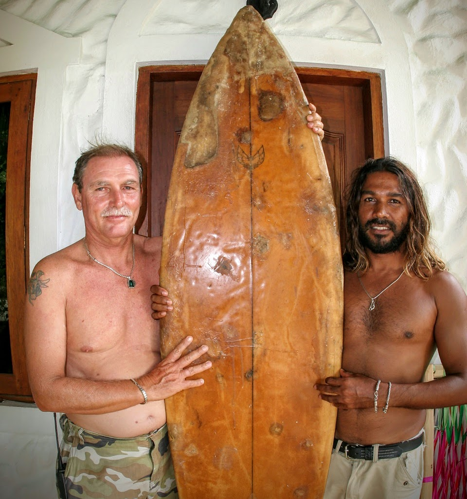 Tony and Dara holding the first surf board brought to the Maldives. The surf board is now in Australia and will soon be displayed at the Surf Museum in Australia.
