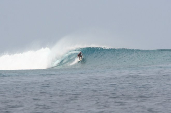 Surfing at Chickens Maldives