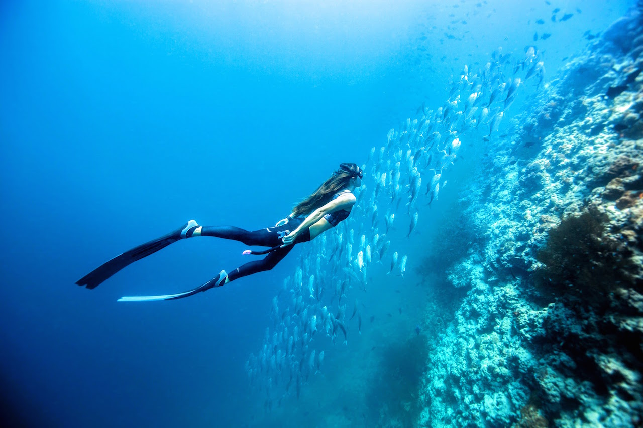 Christina Saenz de Santamaria exploring the depths around Dusit Thani Maldives