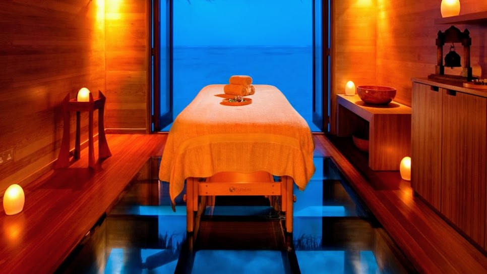 Treatment rooms at The Over-Water Spa have glass floors so guests can watch fish swim past below them during the treatment, Conrad Maldives Rangali Island