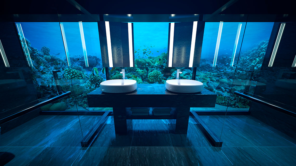 The underwater bathroom looks out onto the floor of the Indian Ocean